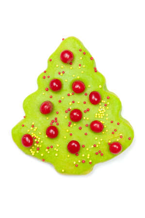 hots: Iced Christmas tree sugar cookie isolated on white