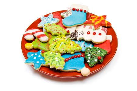 Plate of homemade iced Christmas sugar cookies isolated on white photo