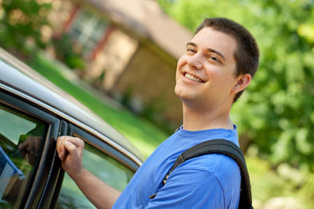 College student getting in car going back to school
