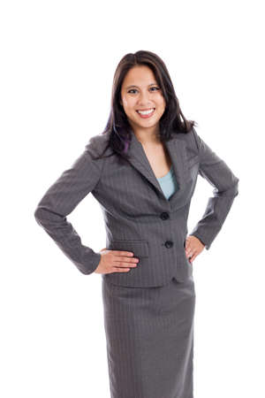 Confident Asian businesswoman with hands on hips portrait isolated on white