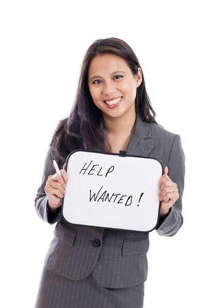 Asian business woman holding help wanted sign on whiteboard photo