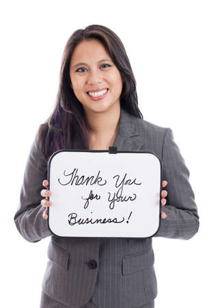Asian businesswoman holding thank you sign isolated on white photo