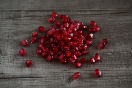 Pomegranate on woodboard photo