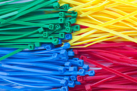 zip tie: Assortment of colorful plastic cable ties   zip ties, tie-wraps  on white background close up Stock Photo