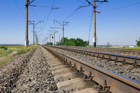 Railway lines with blue sky landscape photo