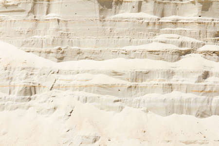 sand pit: Vertical wall of sand in sand pit background
