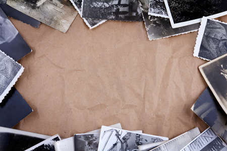 Frame made of old photos crumpled packaging brown paper background Stock Photo