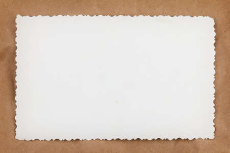 Blank vintage photo back on crumpled packaging brown paper background Stock Photo