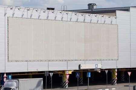 Huge billboard with clear space under shopping center parking Reklamní fotografie