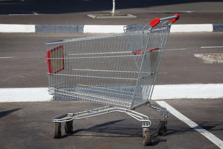 Empty shopping cart in parking lot