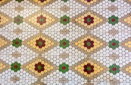 hydraulic tiles or slabs in red, green, orange and white forming decorative patterns