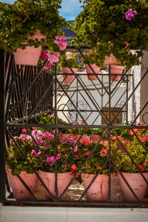 Decoration formed by geranium pots on a beautiful Andalusian balcony