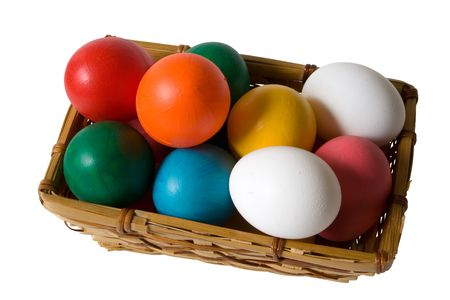 Easter Basket with Real & Toy Colored Eggs. Isolated.