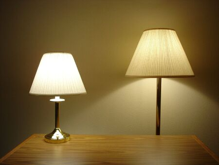 Desktop and Floor Lamps with Wooden Table Stock Photo