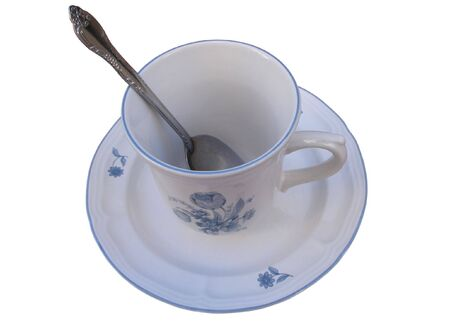 Blue and White Cup with Spoon and Saucer. Isolated. photo