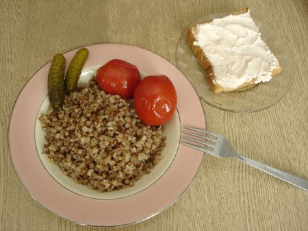 Buckwheat Lunch with marinaded tomato and cucumbers. Sadwich with salted fish butter. photo