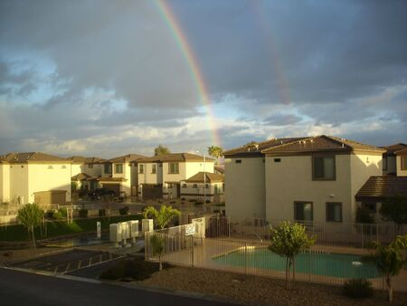 Two Rainbows above Roofs Stockfoto