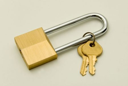 hardened: Keys and Lock with extra long hardened steel handle. On White.