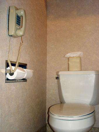 toilet seat: Modern Necessaries - Telephone next to Toilet Seat Stock Photo