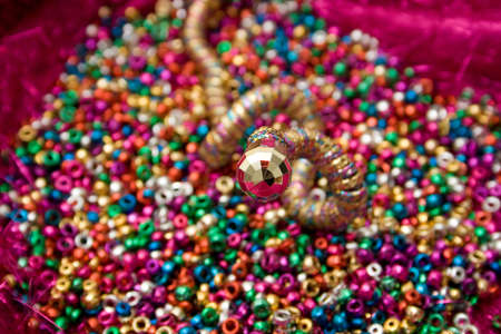 Jewelry snake atop of beads photo