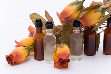 Bottles with shampoo and conditioner with flower