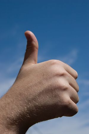 fingering: Vira or Thumb Up on Blue Sky Stock Photo