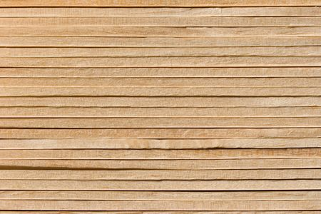 Wooden Background from a tight stack of birch sticks Stock Photo - 546567