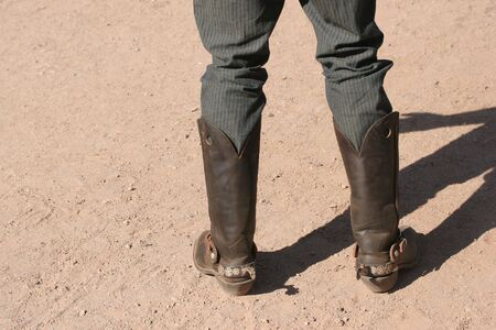 Cowboy wearing leather boots with spurs Stock Photo
