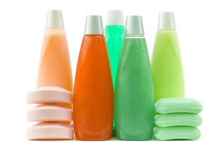 Shampoo and conditioner in bottles, qualitative soap bars, one bottle of mint mouthwash; isolated, clipping path included