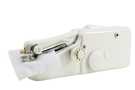 Cordless handheld sewing machine, easy to use; isolated,  clipping path included
