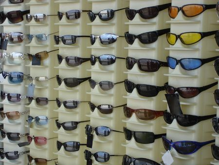 sunnies: Sunglasses displayed for sale