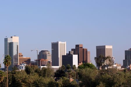 az: Skyscrapers and Single Family Houses Roofs in Downtown of Phoenix, AZ Stock Photo