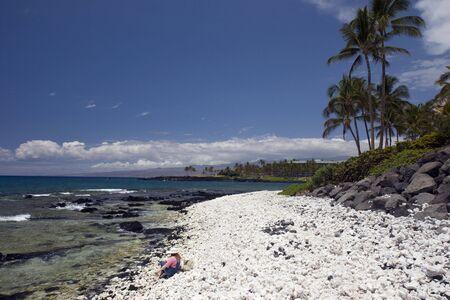 kona: Girl Sitting on Azure Hawaiian Volcanic Coast of Kona Island Stock Photo