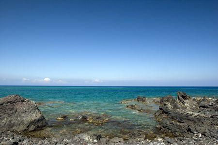 Azure Ocean at Kona Island Volcanic Lava Shore, Hawaii photo