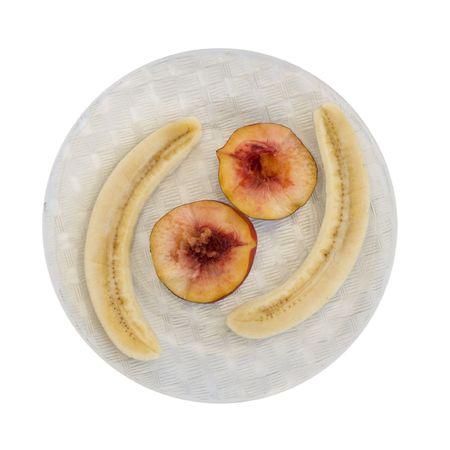 peeled banana: Peeled Banana with Red Peach Halves on Glass Plate; isolated Stock Photo