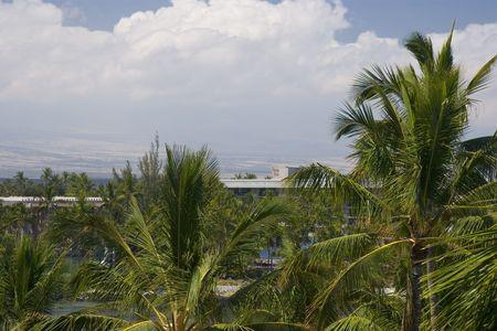 kona: Hawaiian Volcanic Mountains on Kona Island covered with White Clouds
