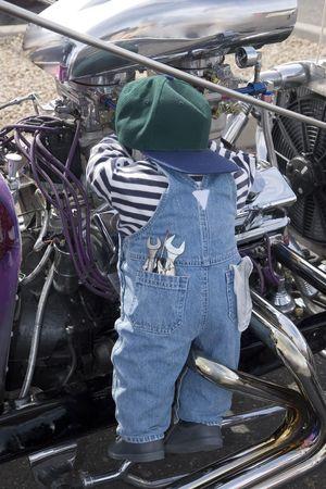 Mechanic working on a Car Engine photo