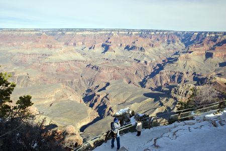 Tourist taking Pictures from Mother Point,  Grand Canyon, Arizona in Winter Stock Photo - 2313007