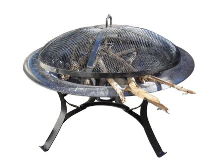 Black Steel Fire Pit with Wood and Charcoal, isolated Foto de archivo