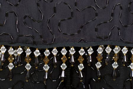 Silver black fabric sparkling jewelry background; close up
