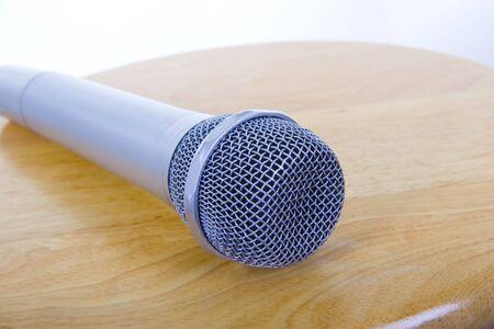 Old microphone on small polish table; closeup, macro photo