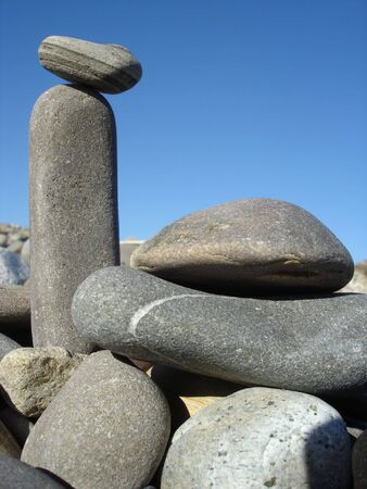 pebblestone: Mother Nature Monuments of Grey Rocks against Blue Sky Stock Photo
