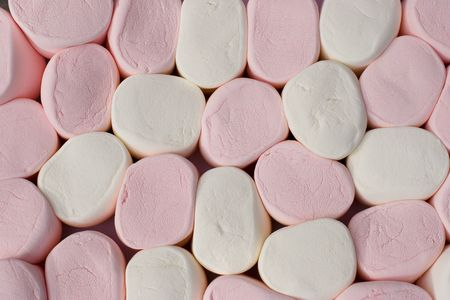 pore: Extra giant marshmallows as on a chess-board background