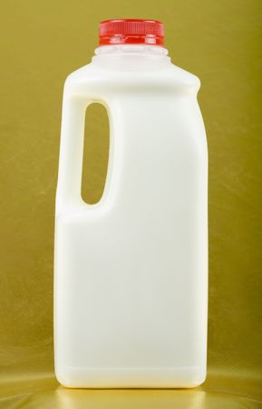 pasteurized: Bottle of milk on golden background; close up Stock Photo