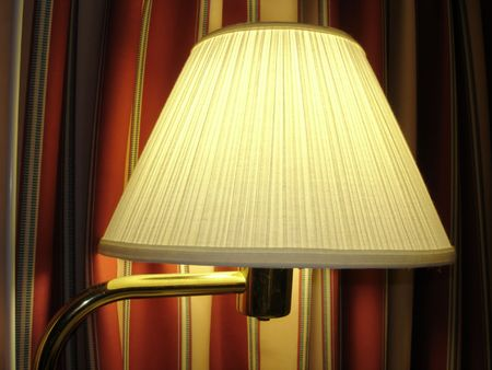 Comfortable Night Lamp against colored curtains; close up Stock Photo - 2969308
