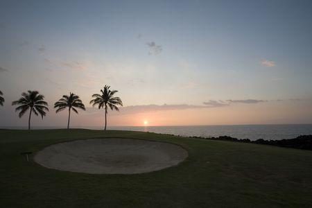 Hawaiian Sunset at Golf Course on Lava Ocean Shore of Kona Island photo