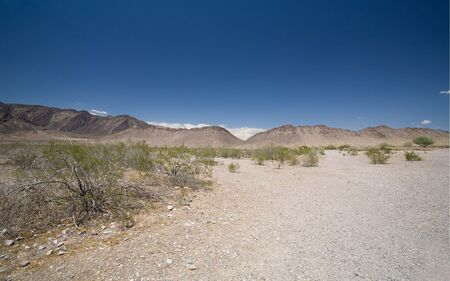 Arid Arizina Desert Mountain Terrain with Creosote Bushes Stock Photo - 3427513