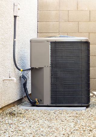 Air Conditioner and Heat Pump Compressor Unit in Backyard
