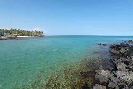 Azure Laguna at Ocean Volcanic Shore of Kona, Hawaii photo