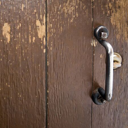 Brown Wooded Door Segment with Metal Handle and Lock
